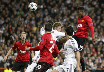 Manchester United's Danny Welbeck scores the opening goal against Real Madrid during their Champions League soccer match at Santiago Bernabeu stadium in Madrid