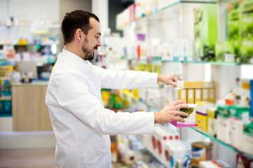 Male pharmacist searching for reliable drug