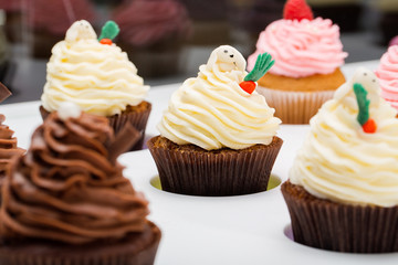 colorful cupcakes with different Tastes. Popular dessert cupcakes on white table. Close up