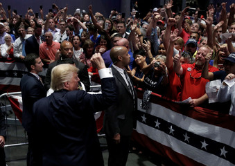 Republican presidential nominee Donald Trump gestures to supporters at a campaign rally in Greenville