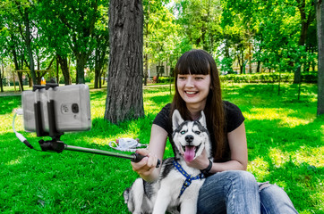 Smile dogs and girls for a photo. summer day