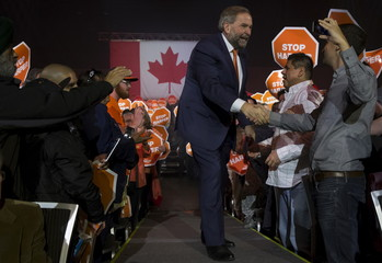 Canada's New Democratic Party (NDP) leader Tom Mulcair greets supporters as he arrives at a campaign event in Vancouver