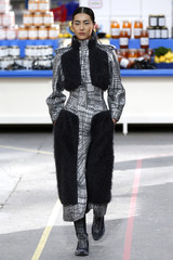 A model presents a creation by German designer Karl Lagerfeld as part of his Fall/Winter 2014-2015 women's ready-to-wear collection for French fashion house Chanel during Paris Fashion Week