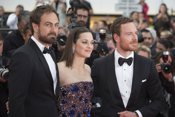 """Director Justin Kurzel, cast members Marion Cotillard and Michael Fassbender pose on the red carpet as they arrive for the screening of the film """"Macbeth"""" in competition at the 68th Cannes Film Festival in Cannes"""