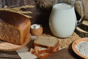 Sliced fresh bread and milk in a jug