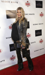 """Fergie Duhamel poses at the premiere of """"Scenic Route"""" in Hollywood"""