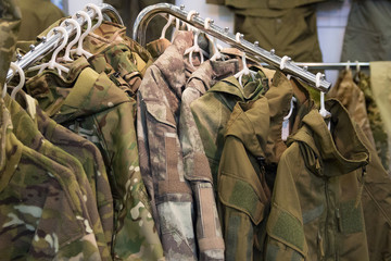Samples camouflage military clothes in the store