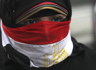 A woman takes part in a protest rally against Egyptian President Mohamed Mursi and members of the Muslim Brotherhood in Cairo
