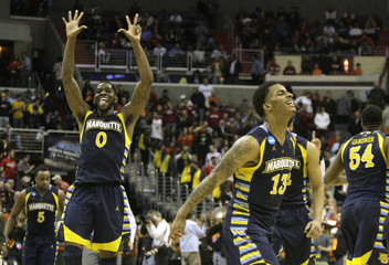 Marquette Golden Eagles Blue and Wilson celebrate after defeating the Miami Hurricanes in their East Regional NCAA men's basketball game in Washington