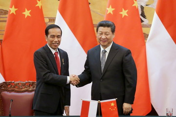 Widodo shakes hands with Xi during a signing ceremony in the Great Hall of the People in Beijing