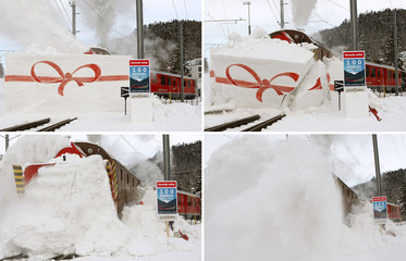 A combination of pictures shows a train of the Rhaetian Railways driving through a wall of snow during an event celebrating the 100th anniversary of the Bernina line in the Swiss mountain resort of St. Moritz