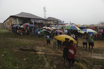 Supporters hold their umbrellas during East Timor's former military commander Taur Matan Ruak's presidential campaign at Letefoho village in Ermera district