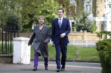 Britain's Chancellor of the Exchequer Osborne arrives with Local Conservative candidate Bray for a visit to the Imaginarium at Ealing Studios in west London
