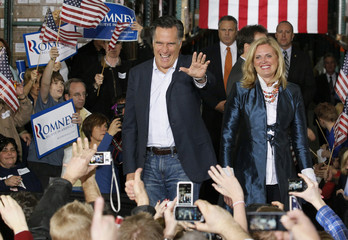 Republican presidential candidate Mitt Romney and his wife Ann arrive at a campaign rally in Las Vegas