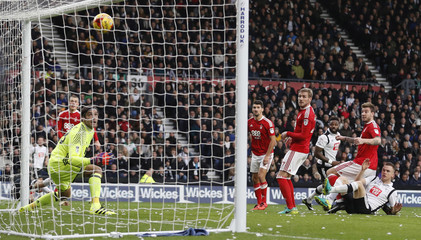 Nottingham Forest's Nicklas Bendtner scores an own goal and the first goal for Derby