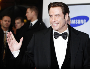 U.S. actor Travolta arrives for the Golden Camera awards in Berlin