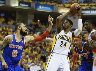 Indiana Pacers' George looks to pass basketball defended by New York Knicks' Chandler during NBA Eastern Conference second round playoff basketball game in Indianapolis