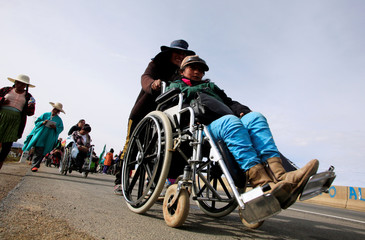 People with physical disabilities participate in a protest march near Ayo Ayo