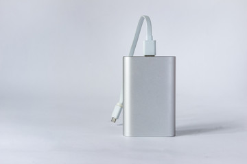 Grey portable external battery ( power bank ) isolated on a white background