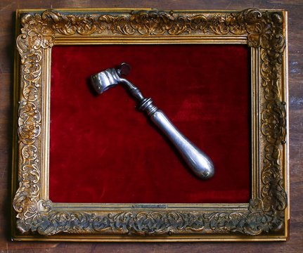 An 18th century tool used by rich people to take food is displayed in an old frame in the Museum of Domenico Agostinelli in Dragona