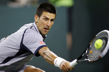 Novak Djokovic of Serbia returns a shot against Sam Querrey of the U.S during their men's singles match at the BNP Paribas Open ATP tennis tournament in Indian Wells, California