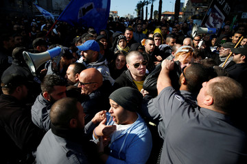 Supporters of Israeli soldier Elor Azaria, who is charged with manslaughter by the Israeli military, clash with police during a protest outside the military court in Tel Aviv