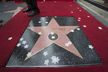 Producer and director Mischer stands by his star after it was unveiled on the Walk of Fame in Los Angeles