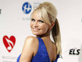 Broadway singer and actress Kristin Chenoweth arrives at the 2011 MusiCares Person of the Year tribute honoring Barbra Streisand in Los Angeles