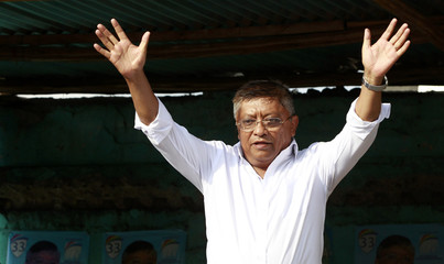 Madagascar's Presidential candidate Jean-Louis salutes his supporters during prayers and a post-elections rally in the capital Antananarivo