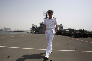 Weapon Engineer Officer Paul O'Shaughnessy of the British Royal Navy Ship, HMS Sutherland walks on the flight deck of the Royal Navy ship HMS Albion at Mina Zayed port