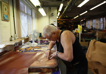 Clicker Ricky Botterill cuts leather uppers at Tricker's shoe factory in Northampton
