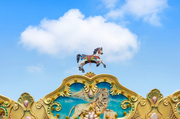 antique carousel horses tent in amusement park