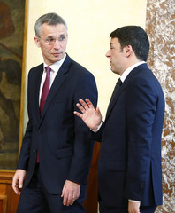 Italian Prime Minister Renzi and NATO Secretary-General Stoltenberg arrive to attend a news conference at the end of a meeting at Chigi Palace in Rome