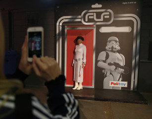 Star Wars fan Nicola Scott, dressed as Princess Leia poses for a photograph in a life size toy box at the  'For The Love of The Force' fan convention in Manchester , northern England