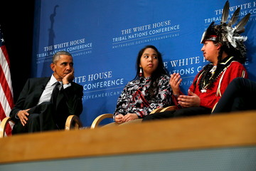 Obama listens as Ticknor and White talk about the problem of suicide in native American communities, at the annual White House Tribal Nations Conference in Washington