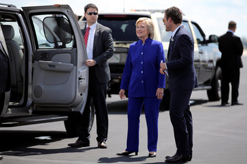 U.S. Democratic presidential candidate Hillary Clinton talks to an aide as she arrives at Orlando International airport to attend campaign events in Orlando
