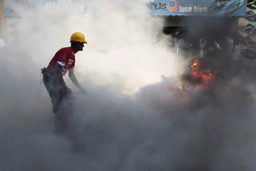 A firefighter puts out flames during an earthquake drill at the Oriental Market in Managua