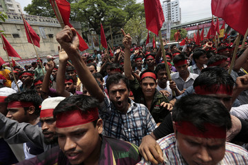 Protesters shout slogans during a Labour Day rally in Dhaka
