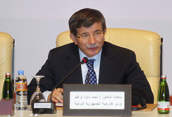 Turkish FM Davutoglu speaks during the General Assembly of the Syrian National Council in Doha