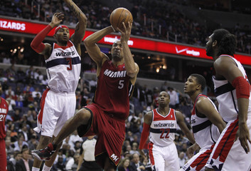 Miami Heat's Howard drives to the basket against the Washington Wizards during their NBA basketball game in Washington