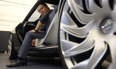 Kim, a South Korean designer for German car manufacturer Opel, poses for a photo in the Monza concept sports car at Opel's headquarters in Ruesselsheim