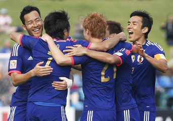 Japan's Yasuhito Endo celebrates his goal with team mates during their Asian Cup Group D soccer match against Palestine at the Newcastle Stadium in Newcastle