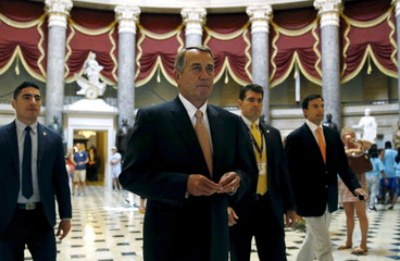 Speaker of the House John Boehner walks to the House Chamber where members of congress were voting on a package of trade bills in the U.S. Capitol in Washington