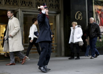 Salvation Army Bell Ringer Nate Hinzman dances for Black Friday shoppers outside Bloomingdales department in the Manhattan borough of New York