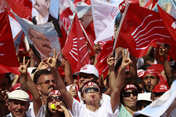 Supporters of Turkey's main opposition Republican People's Party (CHP) wave party flags during an election rally in Istanbul