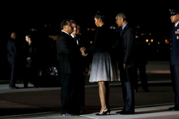 U.S. first lady Michelle Obama consoles Ramos and Davis as she and the president arrive aboard Air Force One at San Bernardino International Airport in San Bernardino, California