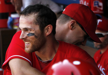Texas Rangers Craig Gentry is hugged by David Murphy after he scored against the Los Angeles Angels in their MLB game in Arlington
