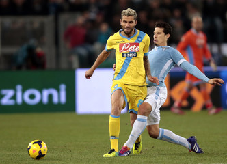 Lazio's Hernanes (R) challenges Napoli's Valon Behrami during their Italian Serie A soccer match in Rome