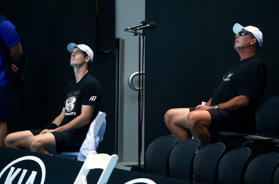 Britain's Andy Murray and his coach Ivan Lendl look up at the sky as they take a break during a training session ahead of the Australian Open tennis tournament in Melbourne, Australia