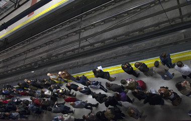 Commuters wait for metro during a general strike in Madrid
